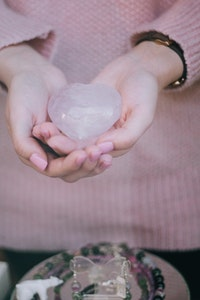 person-holding-heart-shape-stone.jpg